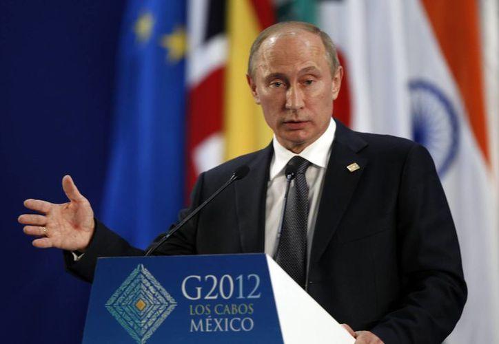 El presidente ruso Vladimir Putin se fortalece en el debate con su homólogo de EU. (EFE)