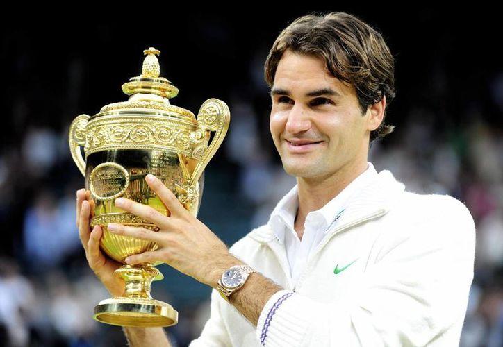 La final de Wimbledon, que en 2014 ganó el suizo Roger Federer, fue uno de los temas más comentados en Twitter. (Archivo/AP)