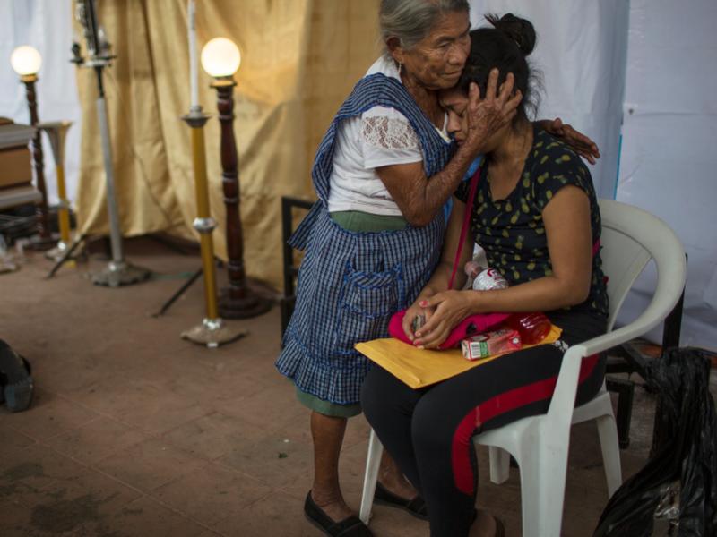 A woman embraces Francisca Nij who mourns the death of her mother Maritza Nij Ramos Davila, 40, during her wake in Alotenango, Guatemala. (AP)