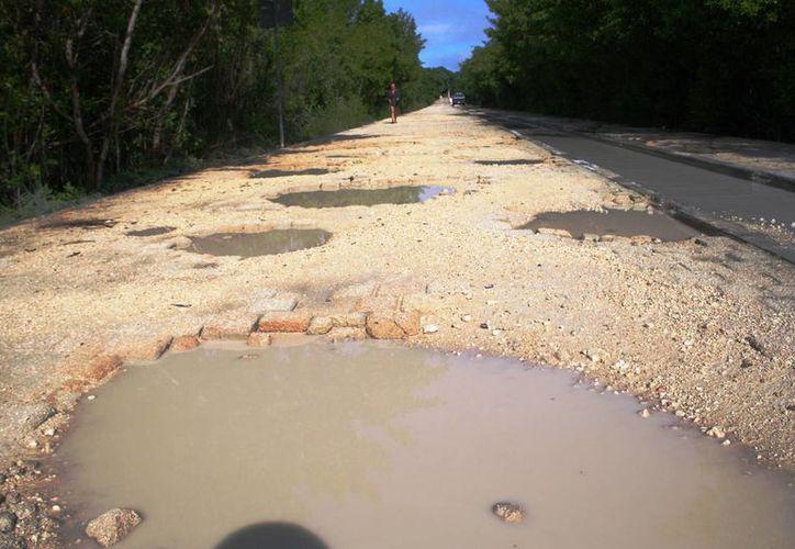 Los accesos a las zona de playas de Punta Esmeralda, Xcalacoco y de la avenida Colosio resultaron dañados tras las lluvias.  (Octavio Martínez/SIPSE)