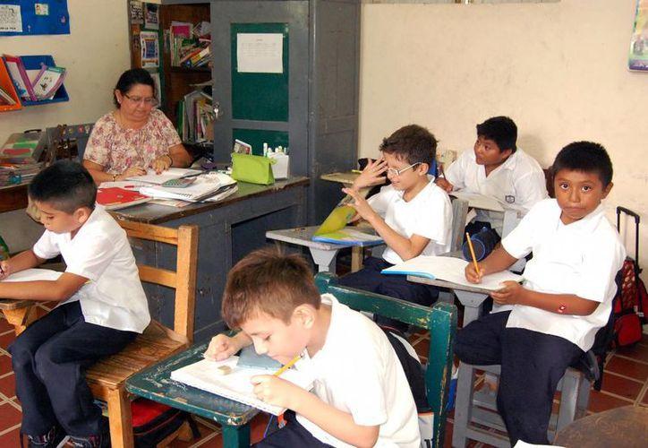 Tras 19 días de vacaciones, hoy reanudan clases en educación básica. Imagen de un grupo de niños en un salón de clases. (Milenio Novedades)