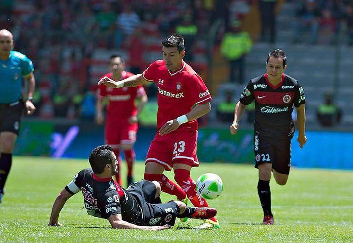 Aunque Xolos tenía el pase asegurado a semifinales del Clausura 2014, Diablos rojos logró sacarlo del torneo. (Facebook/Deportivo Toluca Futbol Club)