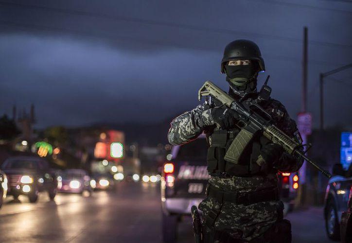 """La Policía Estatal  detuvo a José Ángel alias """"El Kaibil"""", presunto líder de una célula delictiva. (Foto: Cuarto Oscuro)"""