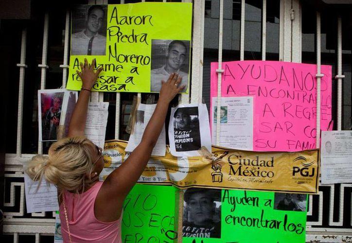 Una vez que peritos argentinos confirmaron que los cadáveres encontrados en una fosa son de los jóvenes secuestrados en el bar Heaven, los familiares reclaman sus cuerpos.  Imagen de contexto de una protesta de octubre del año pasado. (Imagen de contexto/Las5mx)