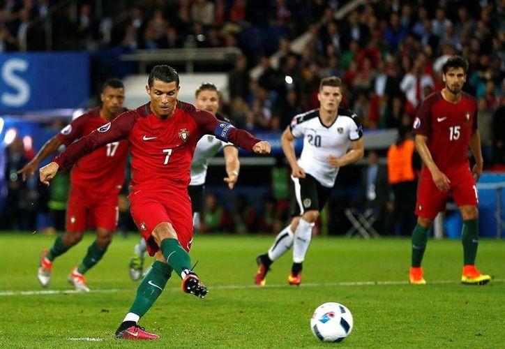 CR7 y los portugueses no traen la puntería afinada a Francia, lo que les valió un empate a cero frente a Austria, a pesar de haber generado oportunidades claras de gol. (EFE)