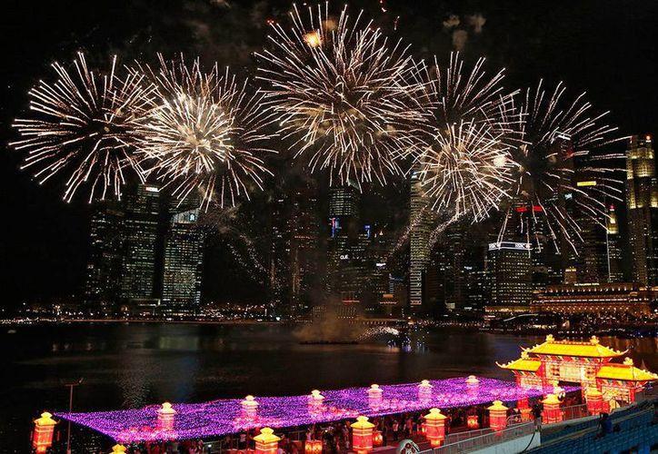 En China suele utilizarse gran cantidad de fuegos artificiales para las grandes ocasiones, tales como el Año Nuevo Lunar. (Archivo/AP)