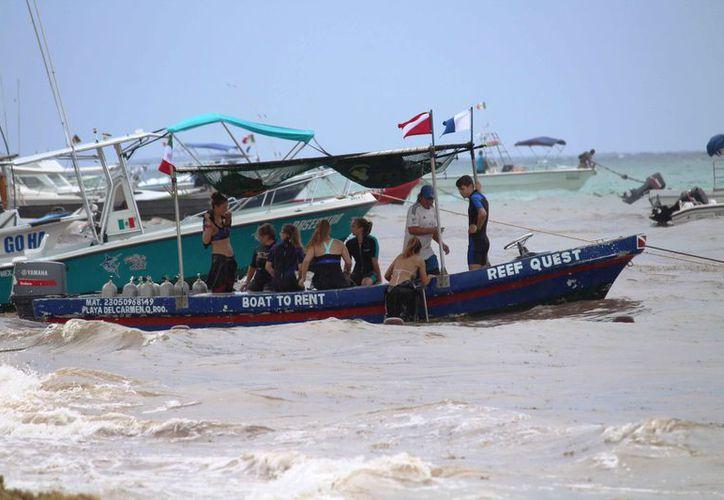 La onda tropical no afectó los servicios turísticos en la zona costera. (Octavio Martínez/SIPSE)