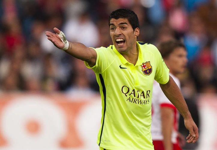 El uruguayo Luis Suárez logró dos pases de gol tras entrar al campo durante en la segunda parte del partido. (AP)