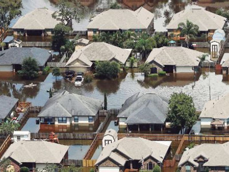 Homes are surrounded by water from the flooded Brazos River in the aftermath of Hurricane Harvey in Freeport, Texas. (AP)
