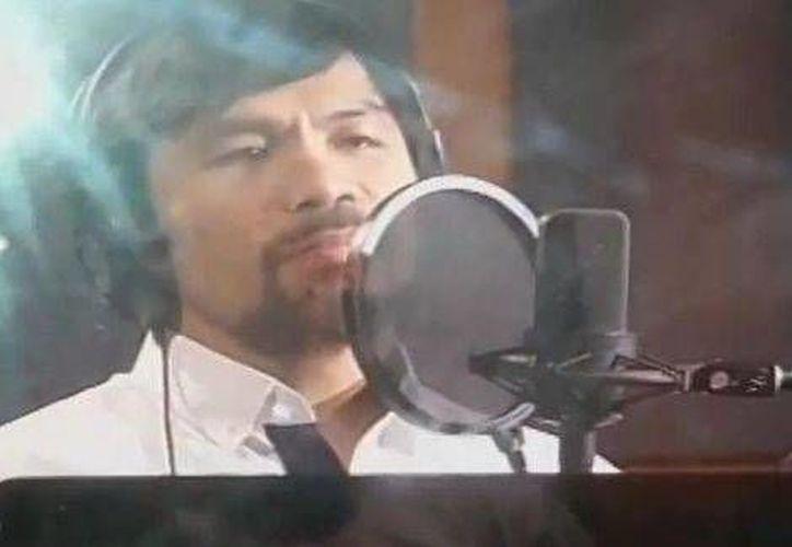 La canción que Manny Pacquiao graba en estos días le servirá para saltar al ring en el que se enfrentará a Floyd Mayweather Jr en mayo. (Foto especial tomada de Milenio)