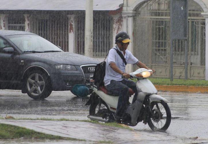 Las lluvias sólo causaron afectación momentánea. (Harold Alcocer/SIPSE)
