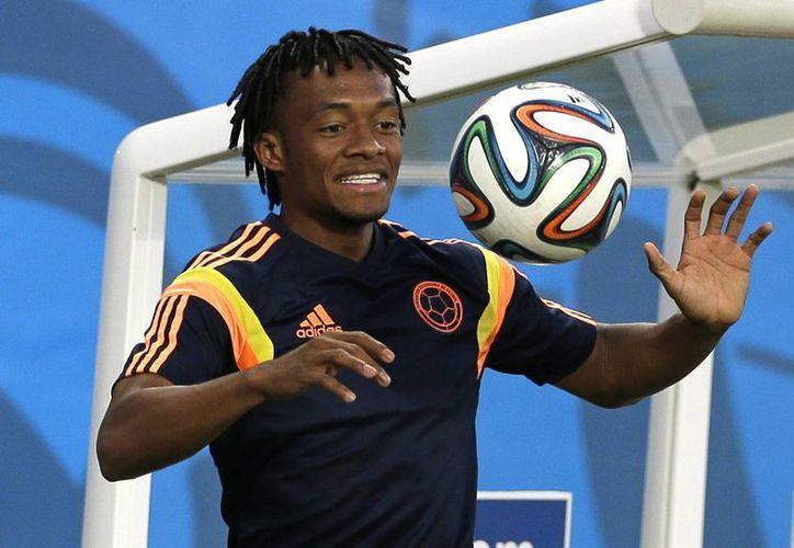 Colombia podría enfrentar a Italia o Uruguay en octavos de final. (AP)