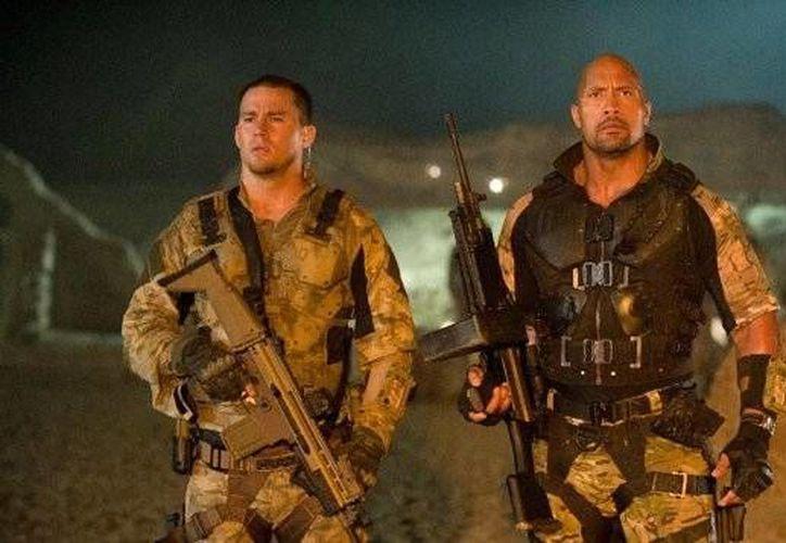 "Channing Tatum (i) y Dwayne ""The Rock"" Johnson durante una escena de GiJOE Retaliation.  (www.news.yahoo.com/Archivo)"