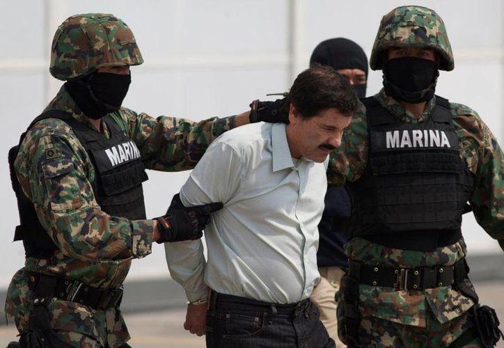 Joaquín Guzmán Loera estuvo un total de 477 días en el penal del Altiplano. Imagen de su ingreso el 22 de febrero de 2014.  (Archivo/Agencias)