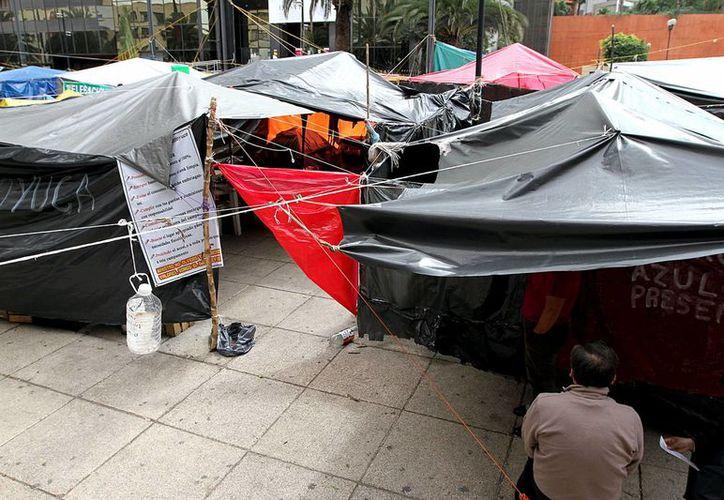 La CNTE acordó en la Asamblea Nacional Representativa el reacomodo del plantón para facilitar el acceso y garantizar la seguridad. (Archivo Notimex)