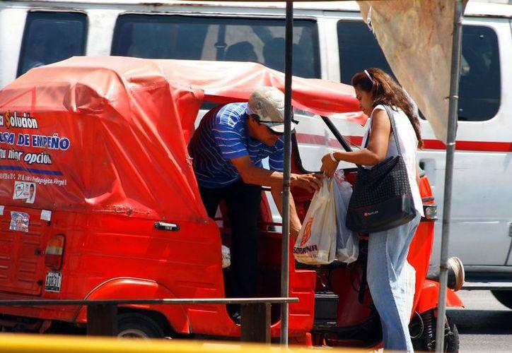 Aprovechando la deficiencia del transporte, los mototaxis proliferan sin control en Mérida. (Novedades Yucatán)