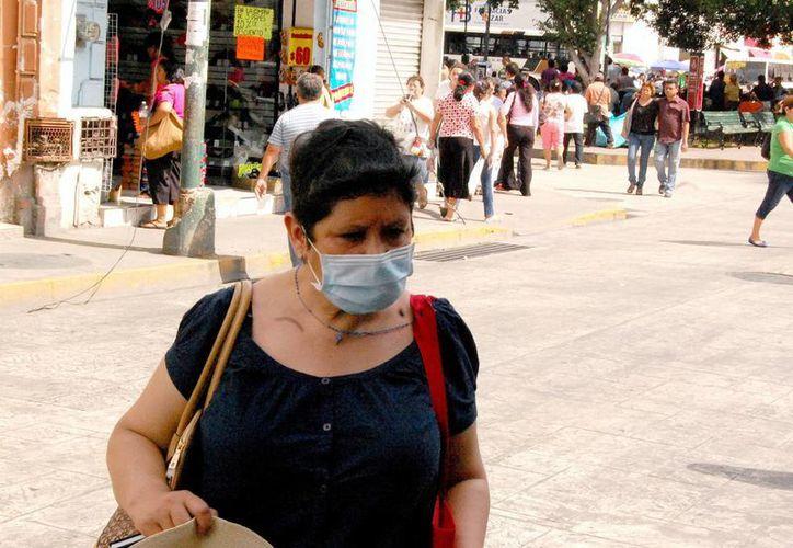 Ante los brotes epidémicos, muchas personas se protegen a fin de evitar estas enfermedades respiratorias. (Milenio Novedades)