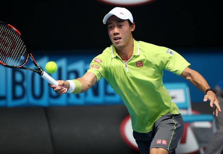 Kei Nishikori, primer asiático en jugar una final de un Grand Slam, ganó su primer partido en el Abierto de Australia. (Foto:AP)