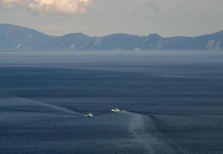 Las autoridades japonesas ya realizan una búsqueda del islote desaparecido en el norte del país. (Excélsior)