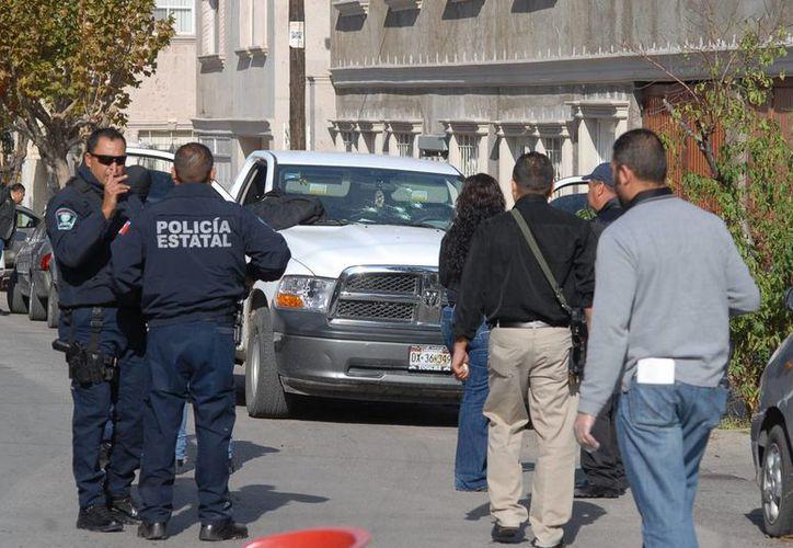 Sicarios atacaron a convoy del jefe de la SSP de Ahome, Sinaloa, Jesús Carrasco Ruiz, quien salió ileso, su escolta, perdió la vida. (Notimex)
