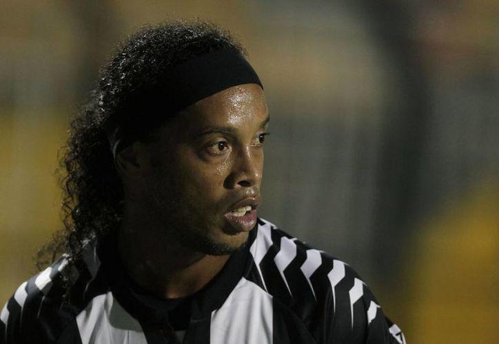 A sus 32 años, Ronaldinho defiende los colores del Atlético Mineiro. (Agencias)