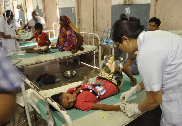 Un total de 23 niños entre 5 y 12 años murieron tras haber comido el almuerzo y muchos otros se enfermaron. (Agencias)