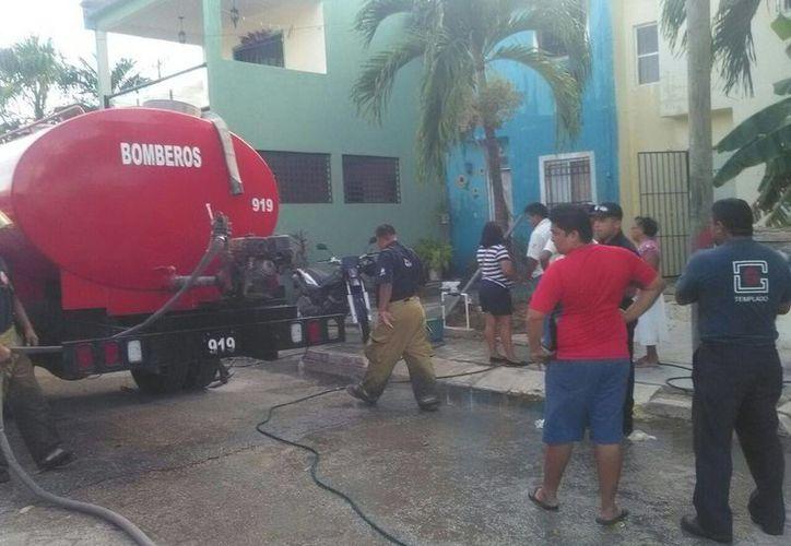 El incendio se registró en una vivienda, ubicada en la Región 105. (Eric Galindo/SIPSE)