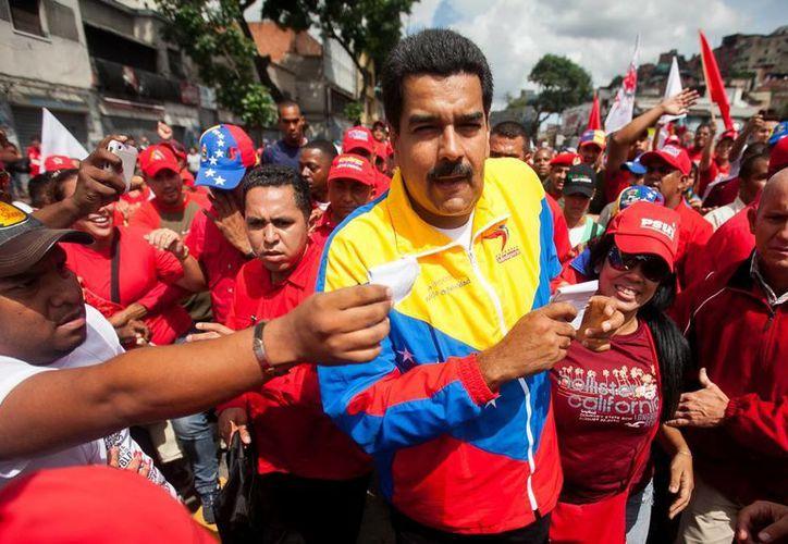 Maduro durante la marcha oficialista del Primero de Mayo, en Caracas. (EFE)