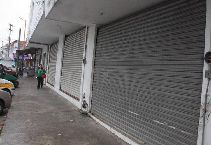 La Canaco afirma que algunos negocios de Cancún han tenido que cerrar por la situación económica actual. (Contexto)