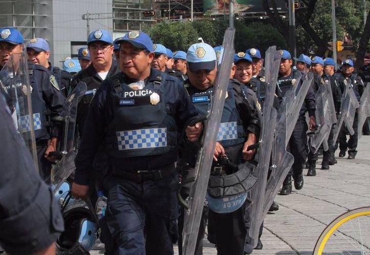 Algunos de los policías capitalinos  detenidos enfrentan cargos por extorsión, robo, ejercicio ilegal del servicio público y secuestro. (Notimex/Foto de contextoi