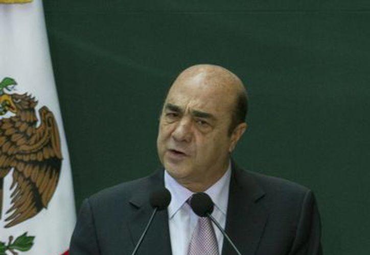 Murillo Karam advirtió que ningún delincuente infiltrado en las autodefensas escapará de la justicia. (Archivo/Notimex)