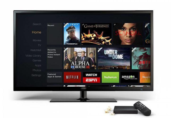 El Fire TV, el dispositivo de televisión bajo demanda en streaming que unirá una oferta de más de 200.000 películas, series y videojuegos para competir con la AppleTV. (EFE)