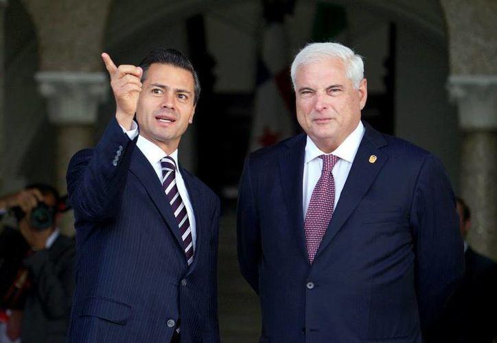 Peña Nieto fue recibido oficialmente a las 9:55 horas por su homólogo de la República de Panamá, Ricardo Martinelli en el Palacio de las Garzas. (facebook.com/EnriquePN)