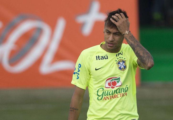 Neymar sólo competirá en uno de los dos torneos programados para el 'scratch du oro' en este año: los Juegos Olímpicos. (Archivo AP)