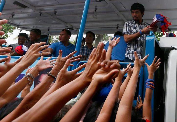 El campeón de boxeo Manny Pacquiao dijo que continuará su campaña política al Senado, a pesar de las amenazas del Estado Islámico. (AP)