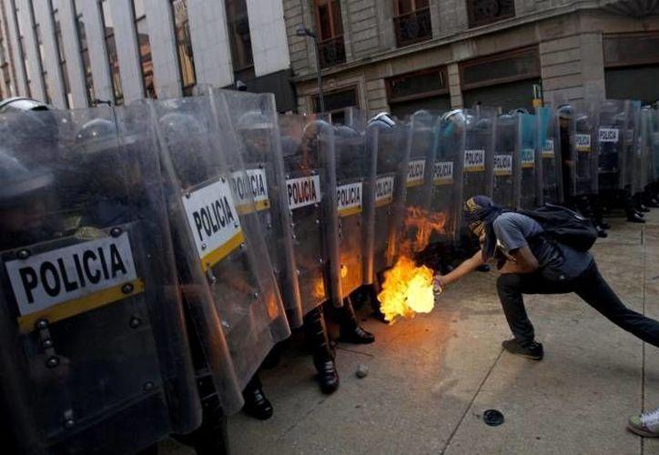 Algunos manifestantes iban con el rostro cubierto. (Archivo/Notimex)