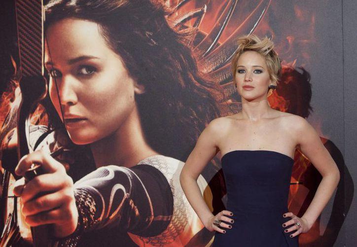 """Jennifer Lawrence supera a Miley Cyrus como Artista del Año de AP. Comenzó 2013 con un Oscar a la mejor actriz, avivó la taquilla con """"Los juegos del hambre"""" y termina el año en """"American Hustle"""". (Agencias)"""