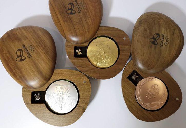 Ganadores en Juegos Olímpicos de Río 2016 obtendrán medallas de oro con mucha más plata que oro, por cuestiones de gastos. (AP)