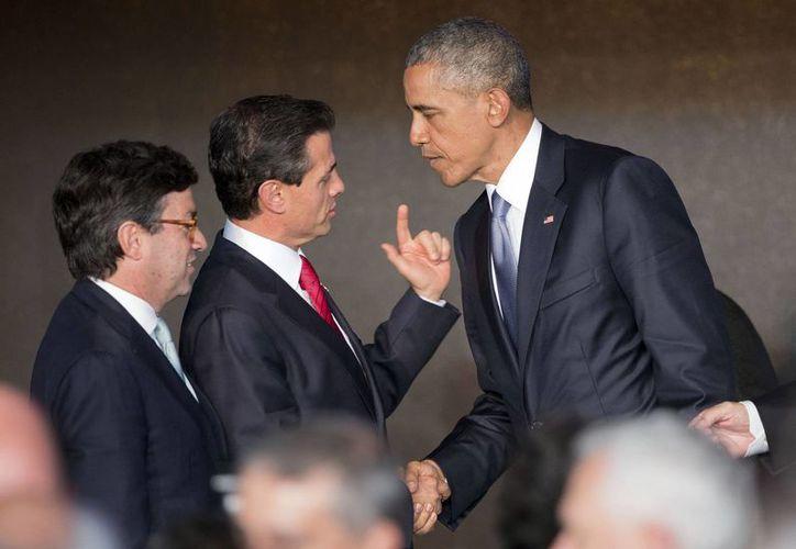 Ante los presidentes de México y Brasil, Obama propuso la creación del Sistema Único Regional de Energía que impulse proyectos regionales.(AP)