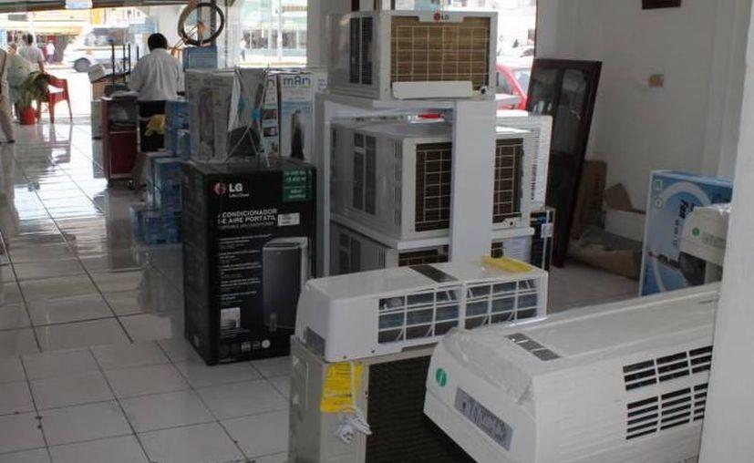 El uso de aires acondicionados dispara el consumo de energía eléctrica en la entidad. (SIPSE)