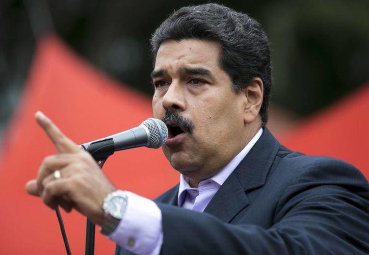 Una vez más la nacionalidad del presidente Maduro, y con ella su legitimidad en el cargo, están en tela de juicio. (AP)