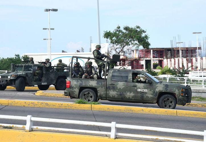 Imagen de los enfrentamientos el pasado 17 de octubre en Culiacán. (Notimex)
