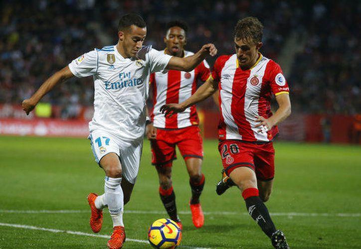 Esta derrota en Girona deja al Madrid a ocho puntos del FC Barcelona. (AP)