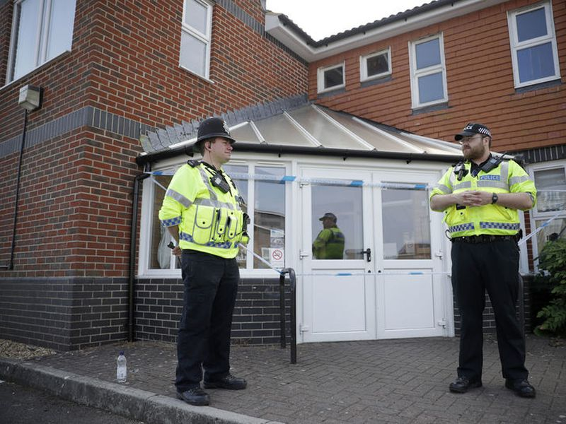 British police officers guards a cordon outside the Amesbury Baptist Centre church in Amesbury, England.