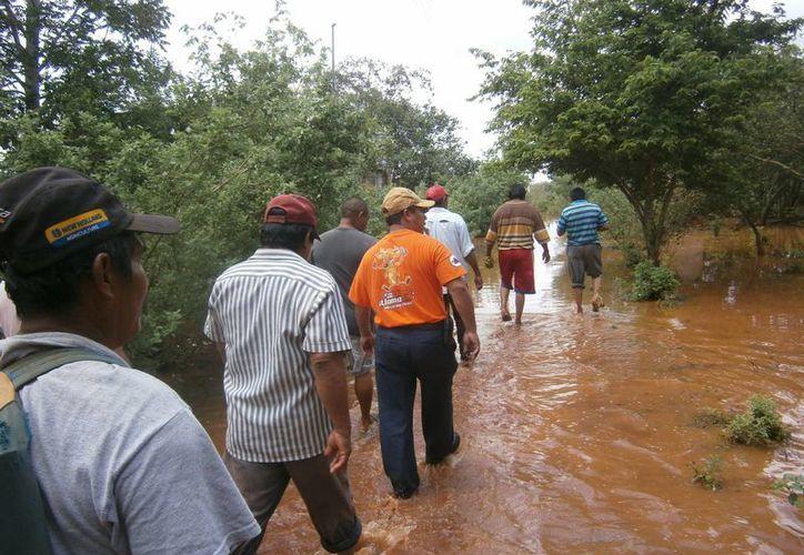 Las inundaciones en el sur de Yucatán se atribuyen a las lluvias que ocasionó 'Andrea' antes de convertirse en ciclón tropical. (SIPSE)