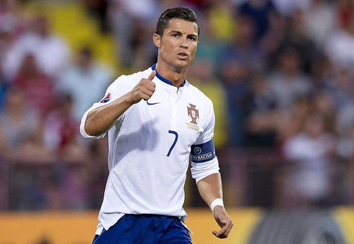 Cristiano Ronaldo una vez más fue la figura indiscutible de la Selección de Portugal, que ganó 3-2 a Armenia gracias a tres tantos del delantero de Real Madrid. (EFE)