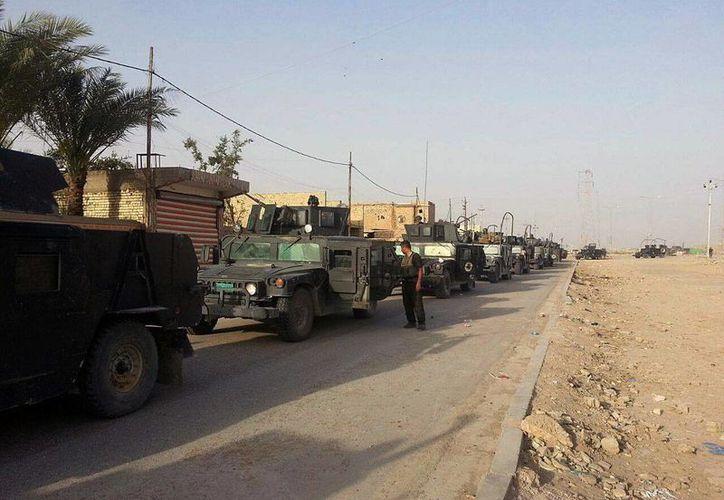 Fuerzas antiterroristas iraquíes entran en Ramadi por el costado este de la ciudad, en Irak, el 18 de abril de 2015. (Foto AP)