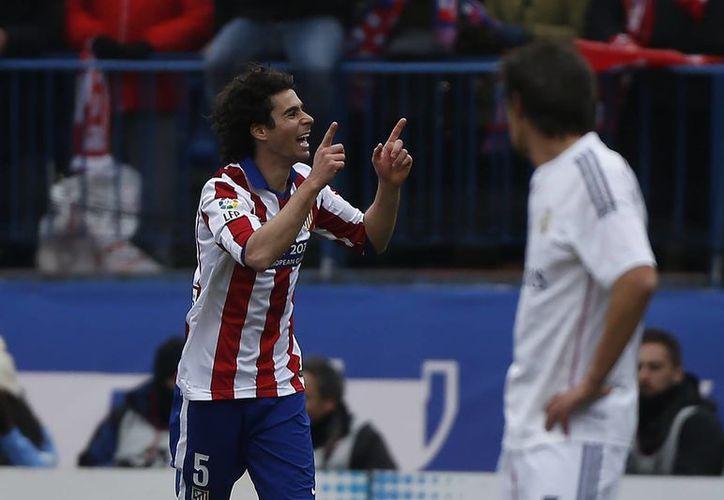 Los goles de Atlético sobre Real Madrid fueron obra de Tiago Cardoso (i), al minuto 14, Saúl Níguez, cuatro minutos después, Antoine Griezmann y Mario Mandzukic. (Foto: AP)