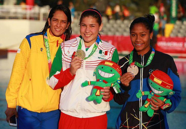 Dolores Hernández obtuvo este domingo su tercer oro en la justa. (Foto: Jam Media)