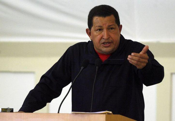 Chávez fue visto por el entonces presidente Bush como una amenaza a los objetivos de EU. (EFE)